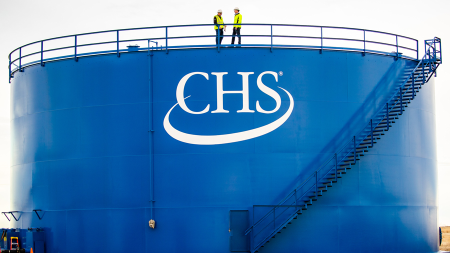 Employees at top of CHS branded storage bin