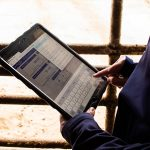 Farmer viewing CHS Pay Online screen on tablet